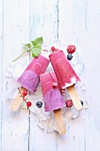 Summer ice cream popsicles with blueberry, raspberry and yogurt