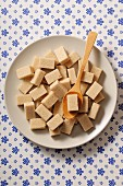 Cane sugar cubes on a white plate