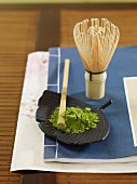 Matcha powder and a tea whisk (Japan)