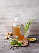 Vegetable stock in a glass apothecary bottle