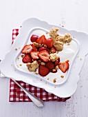 Yoghurt dessert with strawberries and sprinkles