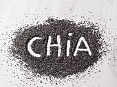 The word 'chia' written in a pile of chia seeds