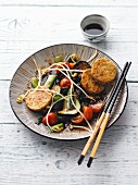 Courgette vegetable dish with shoots and tempeh