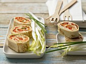 Tortilla rolls with chicken, papaya and peppers