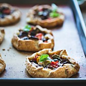 Savoury eggplant galettes with olives, tomatoes and basil