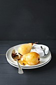 Poached pears with caramel sauce and whipped cream