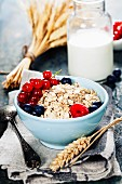 Healthy Breakfast: Oat flake, berries and fresh milk