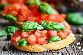 Tomato bruschetta with chopped tomatoes and basil on toasted bread