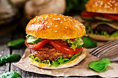 Vegetarian burger with grilled champignon, tomato and cucumber
