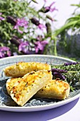 Fennel quiche with lavender blossoms, in pieces