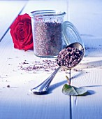 Rose salt in a glass and on a spoon with a rose
