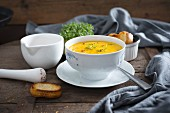 Vegan carrot soup with cress and red pepper