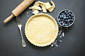 Tart dish with pastry base before being filled to be baked