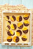 Candied orange and lemon slices with dark chocolate glazing