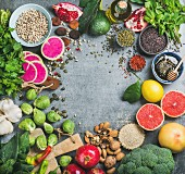 Variety of vegetables, fruit, seeds, cereals, beans, spices, superfoods, herbs