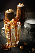 Beer milkshake with caramel sauce, pretzels and popcorn for Halloween