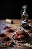 Little buttery, crumbly, eggless cookies, dusted with cocoa powder that look like small chocolate truffles