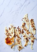 White chocolate with salted almonds, sumac and orange