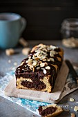Marble cake with chocolate glaze and flaked almonds