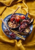 Chickpeas with fried aubergine, caramelised onion and dried pomegranate seeds