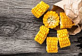 Delicious grilled corn on a wooden board