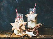 Bottle with milk, Christmas festive gingerbread star shaped cookies