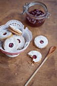 Spitzbuben (jam cookies) with a doiley in a small bowl
