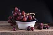Red grapes in an enamel dish