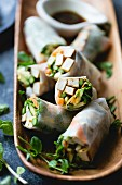 Grilled asparagus tofu spring rolls with ginger-lime dipping sauce
