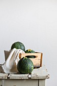 Round courgettes in a wooden box