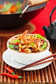 Asian stir fried noodle with vegetables and shrimps