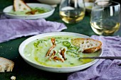 Cream of Potato Chive Soup with Chili Oil, Roasted Jalapeno and Crispy Potato Skins
