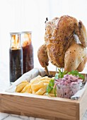 Roast chicken served standing, with chips