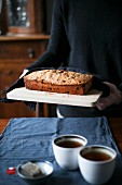 Raisin cake with black tea