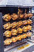A grilled chicken stand at a market