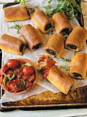 Bread rolls with a chard filling and tomato sauce
