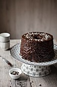 Marble chiffon cake with chocolate frosting on grey table