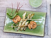 Salmon fillet skewers with asparagus and sorrel cream