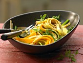 Colourful vegetable noodles with saffron sauce