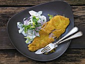 Trout in a polenta crust with a cucumber and apple salad