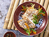 Asian spined loach fillet with julienne vegetables, ginger and chili