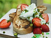 Yeast bread bruschetta with mint quark, strawberries and pistachios