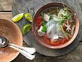 Glass noodle soup with chicken, sugar snaps and peppers (Asia)