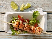 Grilled salmon skewer with fennel and tomato salsa