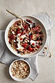 A wild berry salad with almonds, quinoa and maple syrup