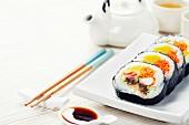 Sushi set, green tea on bamboo mat