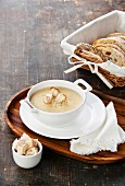 Cheese soup on textured wooden background