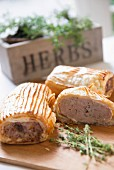Sausage rolls and herbs