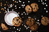 Rich oat cookies with raisin and chocolate chips, having crunchy edges and flavorful chewy center