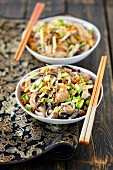 Soya pasta fried with chicken and mushrooms